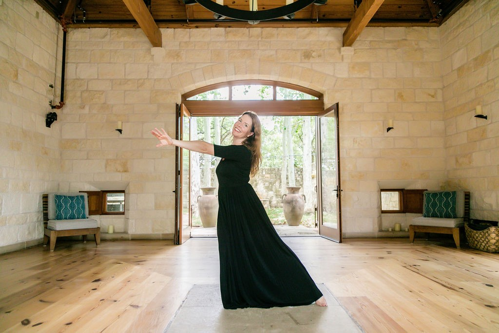 woman dressed in black dancing