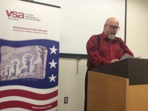 Veteran speaking at podium during event